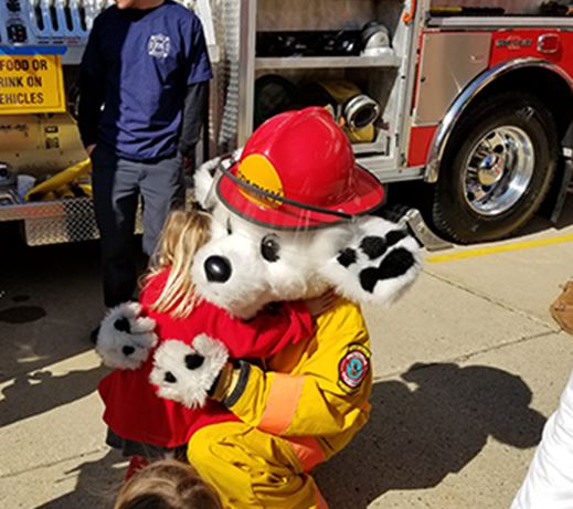 Person in fire dog costume with kids